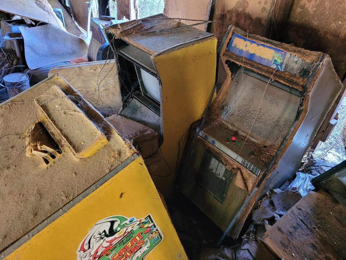 Frogger may have survived the dangerous roadway, but the arcade machine itself was no match for neglect in this abandoned warehouse.