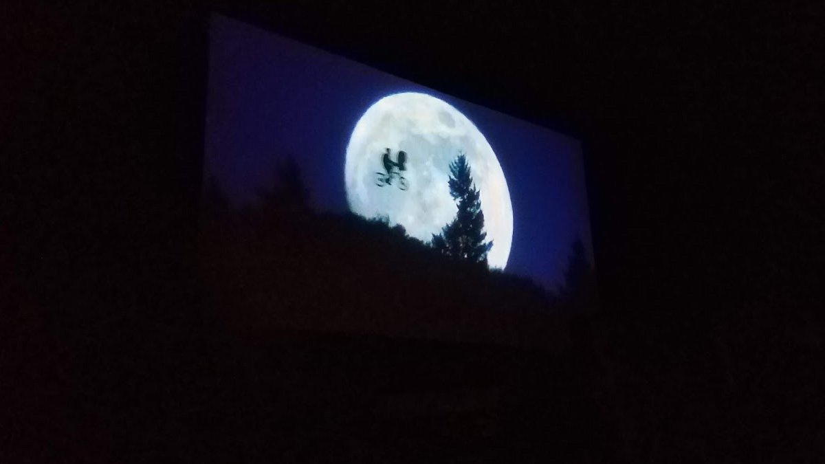 E.T. flying into the night sky across the movie screen at Swan Drive-In in Blue Ridge, GA