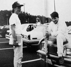 Friends hanging out in a parking lot. Black & white photo circa 1994